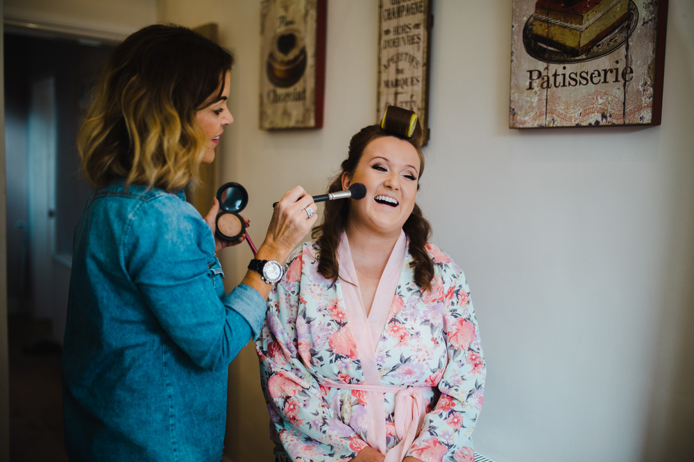 The bride getting her wedding makeup on- Documentary photographer