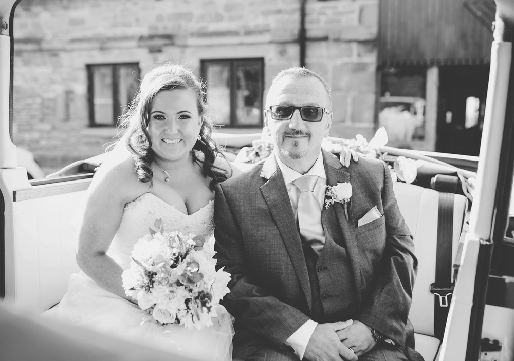 The bride and hThe bride and her father in the wedding car- Lancashire wedding photography.