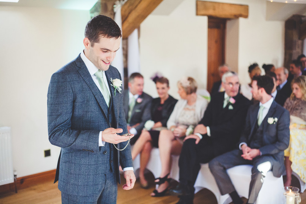 The groom at the alter at Beeston Manor