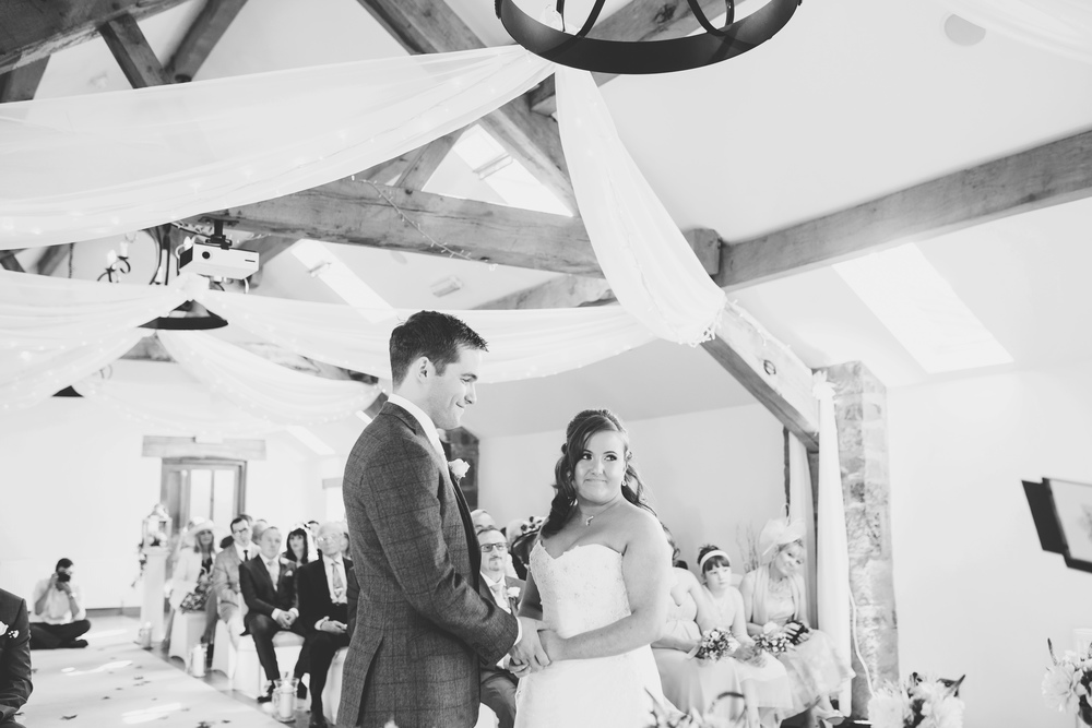 Black and white photograph of the bride and groom in Beeston Manor for their wedding.