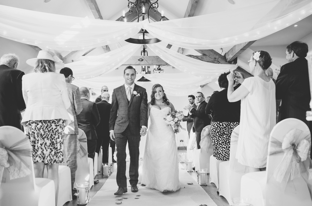 Documentary images of the bride and groom walking back down the aisle. Lancashire wedding photographer.