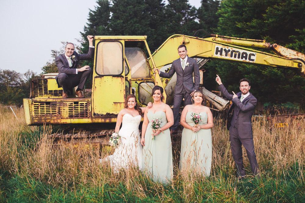 The bride, bridesmaids, groom and groomsmen. -Creative wedding photographer