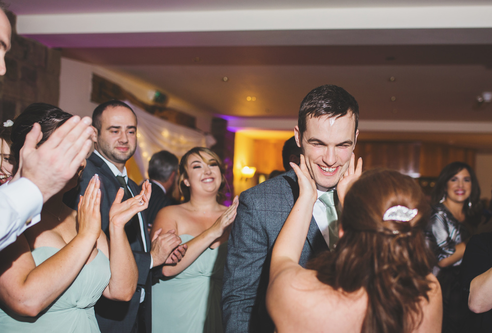 The bride and groom hitting the dance floor with their wedding guests.- Beeston Manor wedding venue