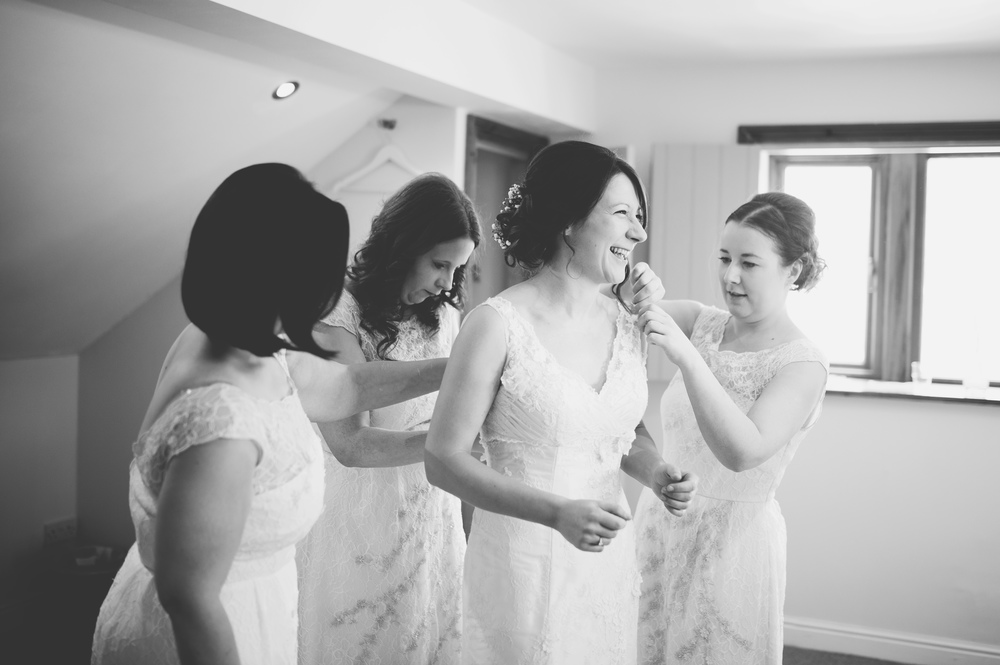 Documentary wedding photograph of the bride and bridesmaids. Lancashire wedding.