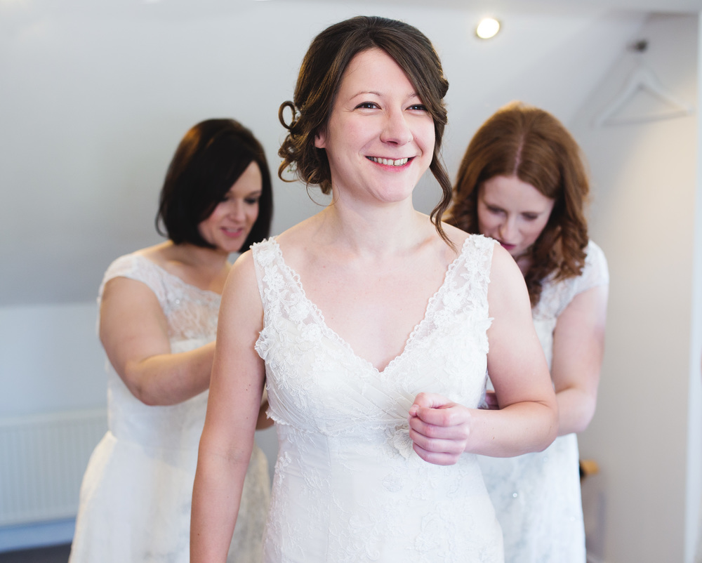 Bride having her dress done up, Ribble Valley Wedding.