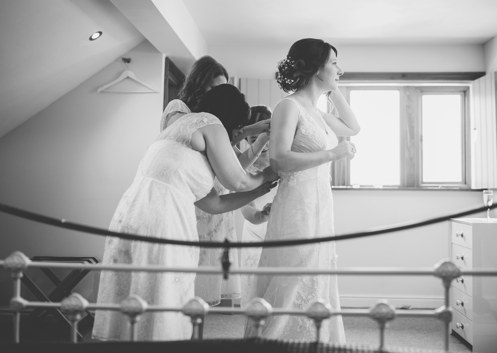 Documentary black and white photograph of the bride and bridemaids. - Relaxed wedding Lancashire
