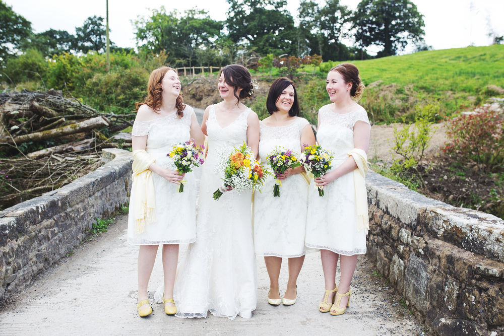 Creative wedding images of the bride and bridesmaids at The outbarn at Clough Bottom.