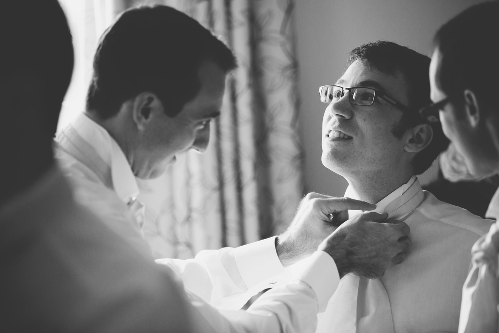 Black and white photograph of the grooms getting ready for the country wedding.