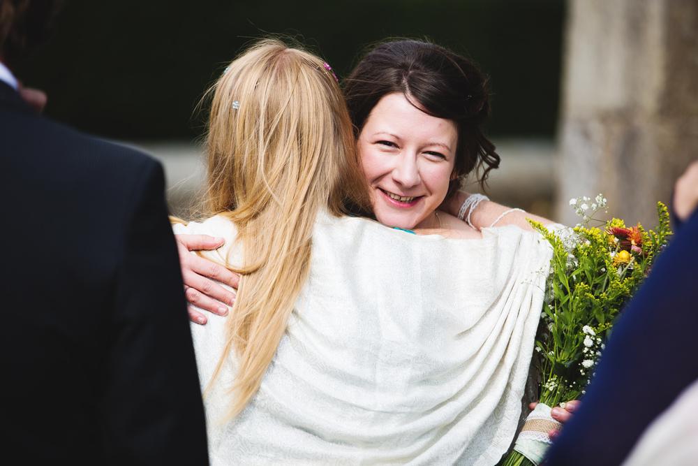 Documentary wedding photographer captures guests hugging- Lancashire wedding.