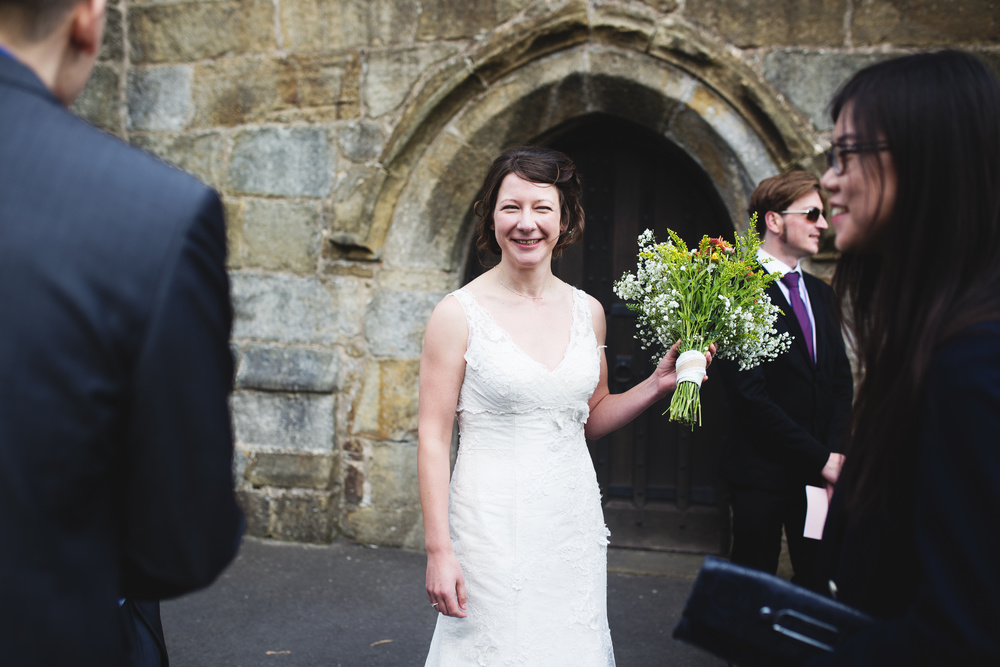 Wedding guest ccatches the bouquet. Ribble Valley wedding