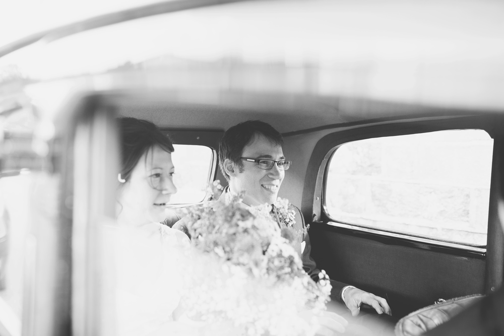 Black and white photographs of the bride and groom in the car.- Lancashire wedding photographer.
