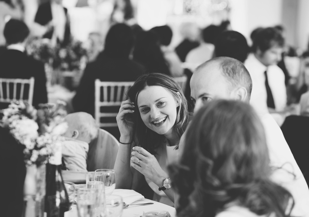 Ducumentary wedding photographer capture wedding guests laughing.