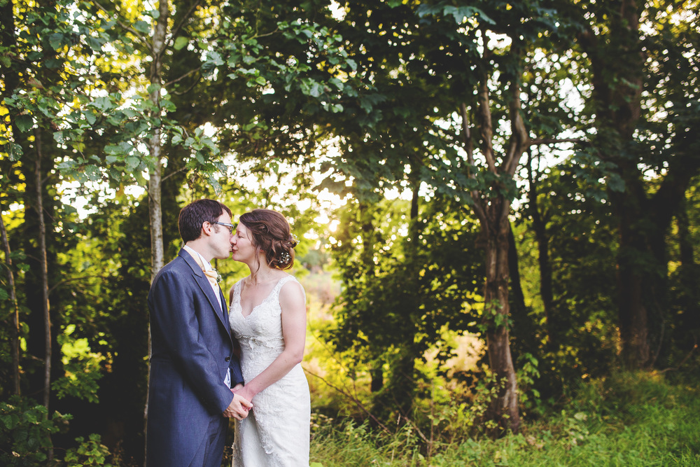 The ride and groom surrounded by woodland- Relaxed wedding photographer