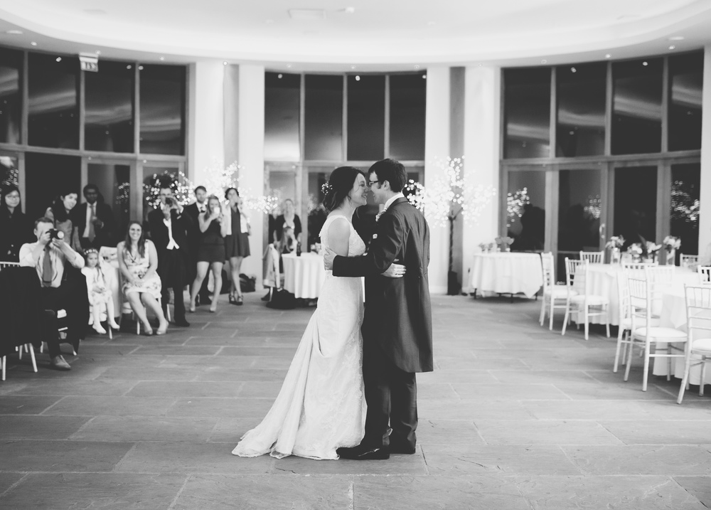 Documentary photograph of the bride and grooms first dance, black and white image - Lancashire wedding photographer