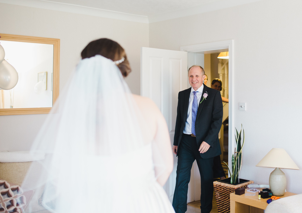 Father of the bride walking in to see his daughter- Documentary Photography