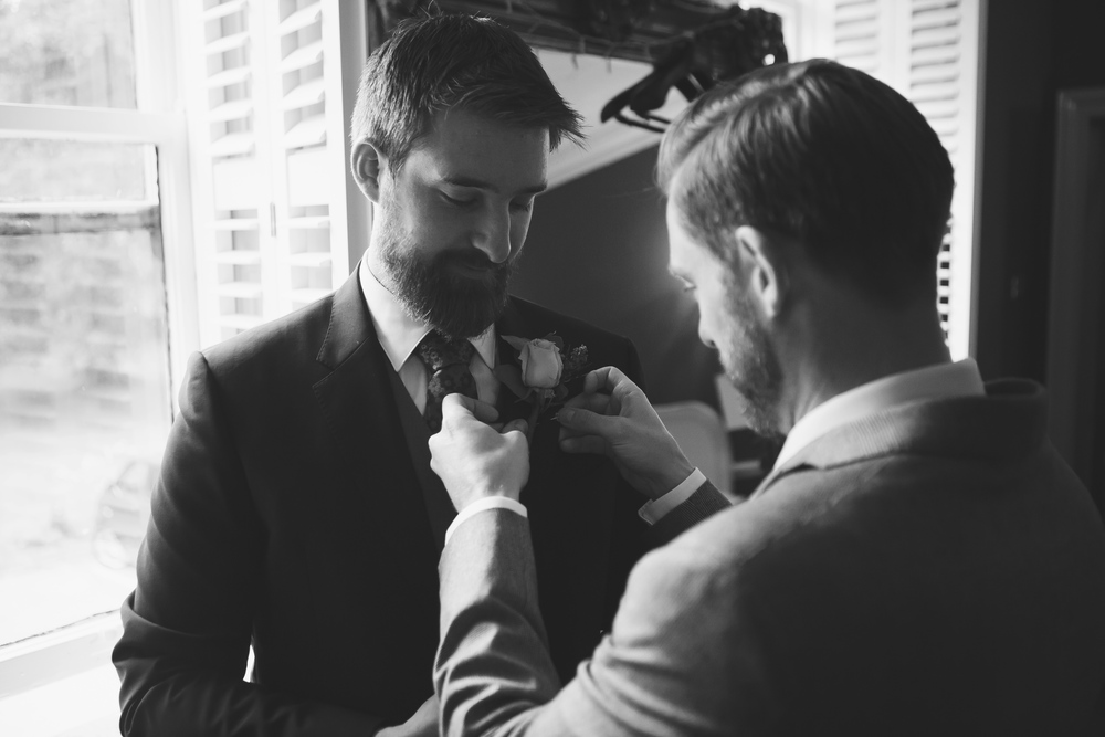 Black and white photograph of the groom getting ready for the wedding at Sparth House - Lancashire wedding photography
