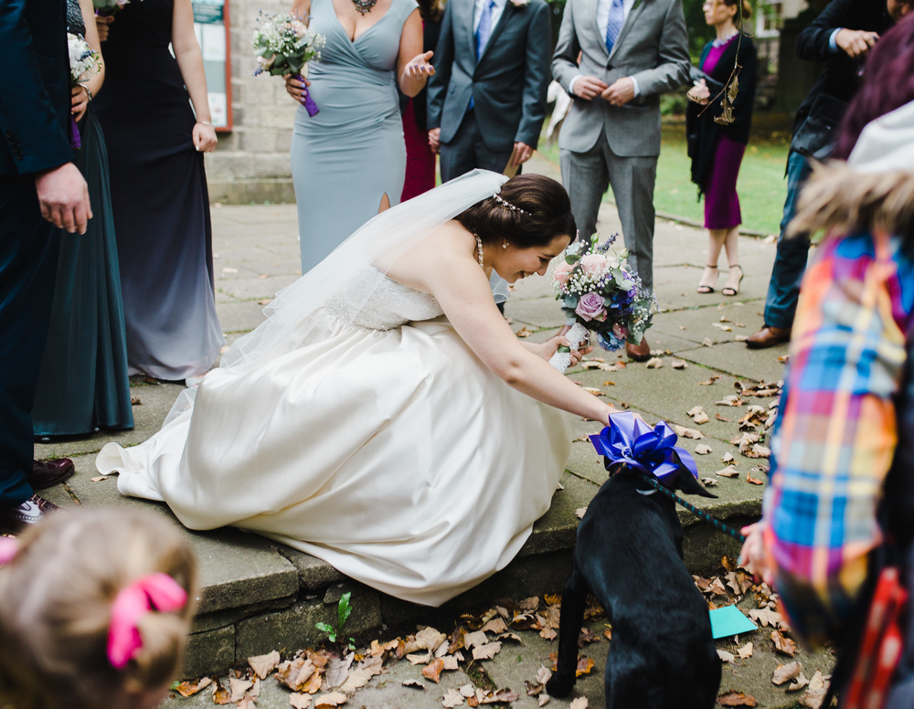 The bride with her dog after the wedding ceremony at Sparth house, Accrington