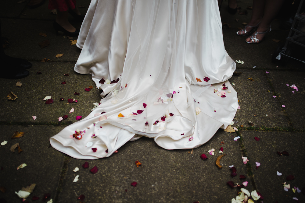 Flower petals on the bridal dress - Mad hatter themed wedding