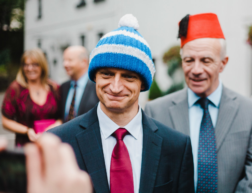A wooly hat is a choice for one wedding guest- Lancashire mad hatter theme wedding