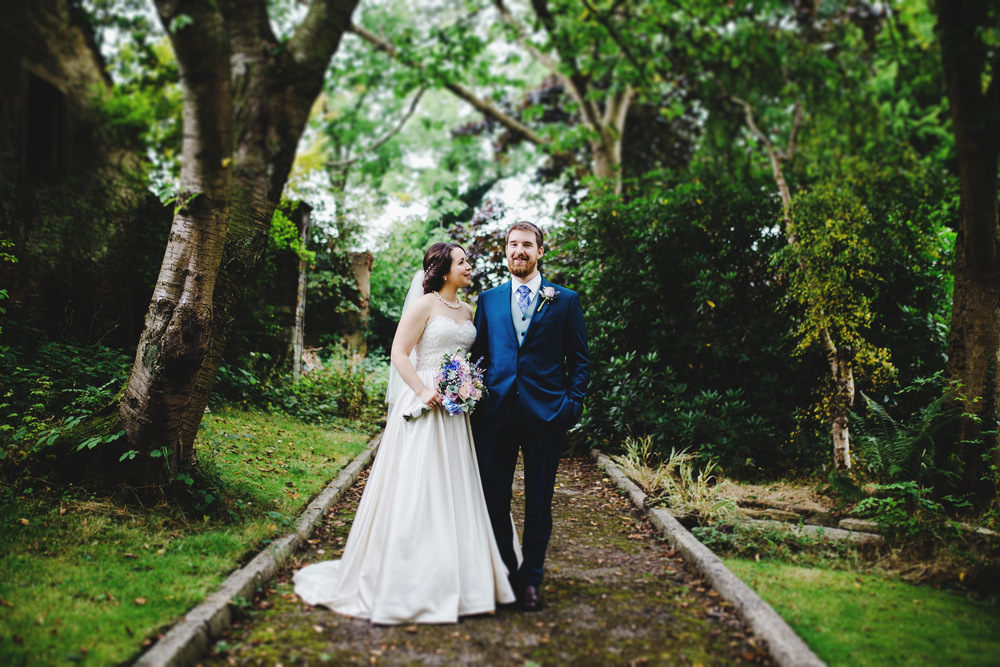 Bride and groom on the woodland path way- Creative wedding photography