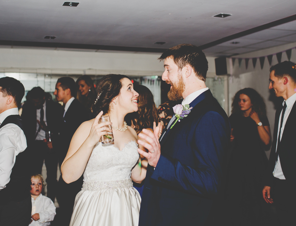 Bride and groom with drinks at hand on the dance floor- Accrington, Sparth House photography