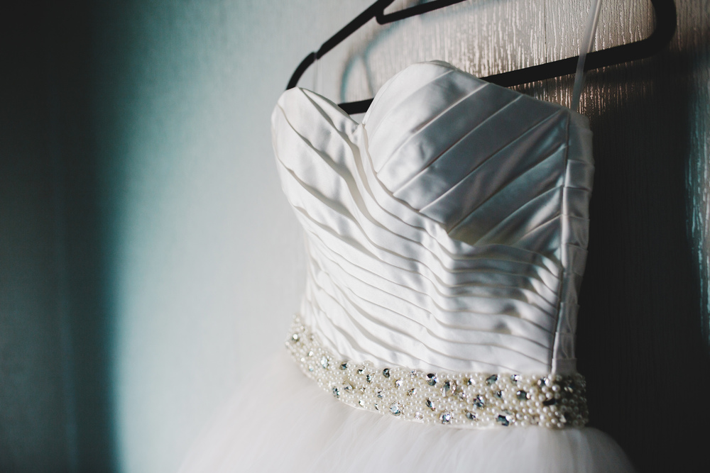 The brides dress hung up -Avenham Park outdoor wedding