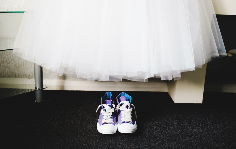 The brides dress above the shoe for the day, Converse- Lancashire wedding photography