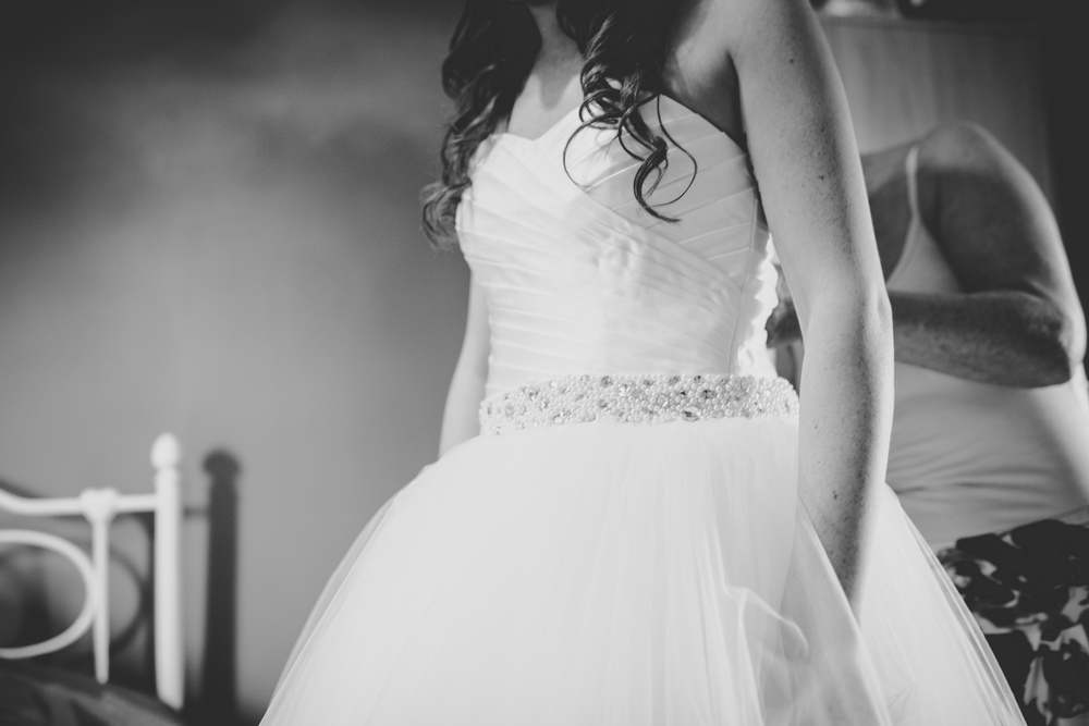 Black and white photograph of the bride in her dress- Documentary photography