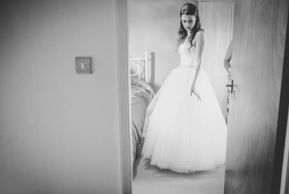 Candid photograph of the bride in her dress, black and white- Relaxed wedding