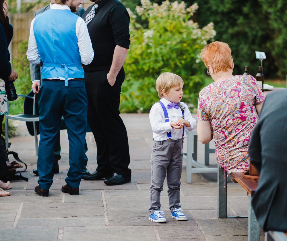 One of the younger best men in his little converse-  Outdoor wedding