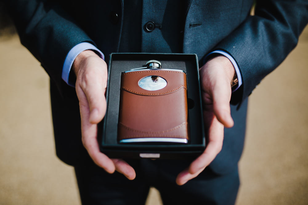 Best man gift from the groom is a flask- Creative wedding images
