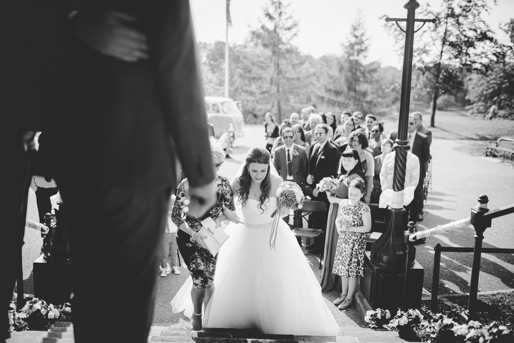 Black and white photograph of the bride walking up the aisle- Documentary photography