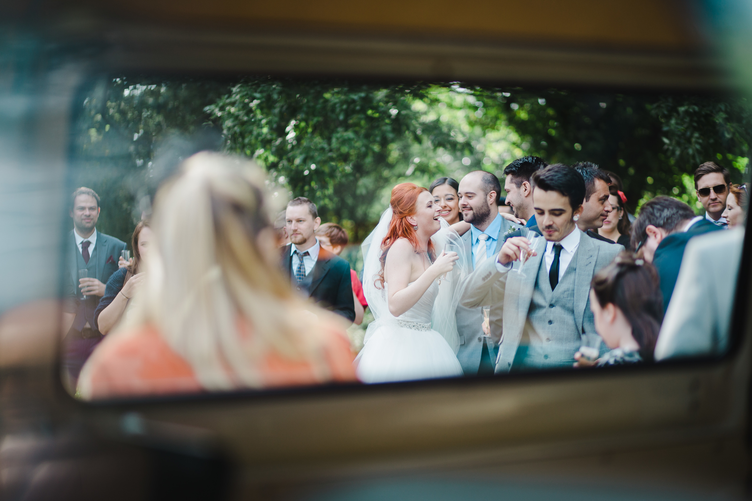 bride enjoys drinks with guests - Preston Wedding Photographer