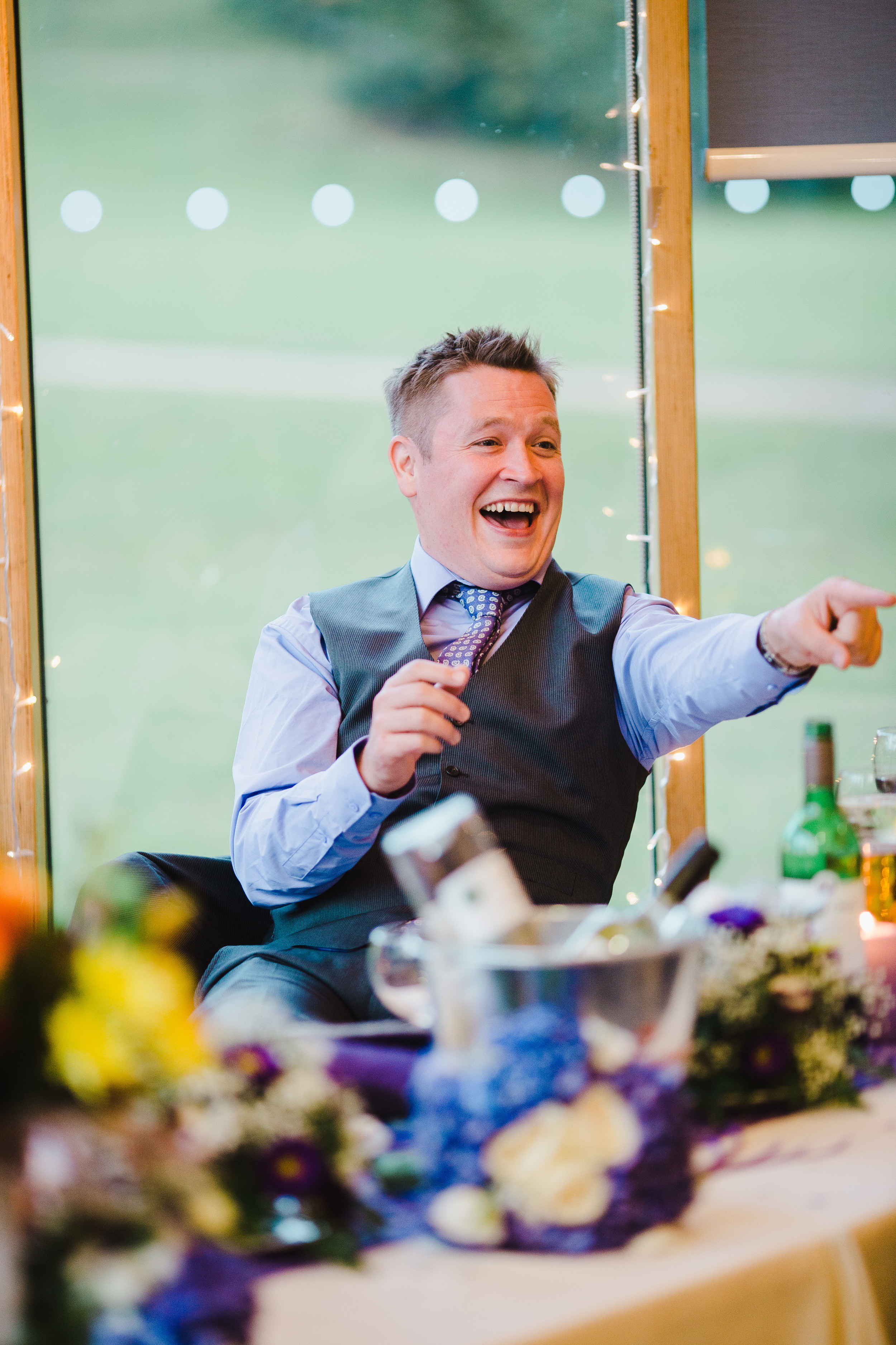 guests laughing - documentary wedding photography Lancashire