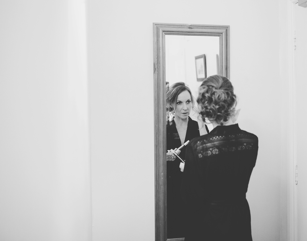 Black and white photograph of the bride getting ready- Lancashire wedding photographer