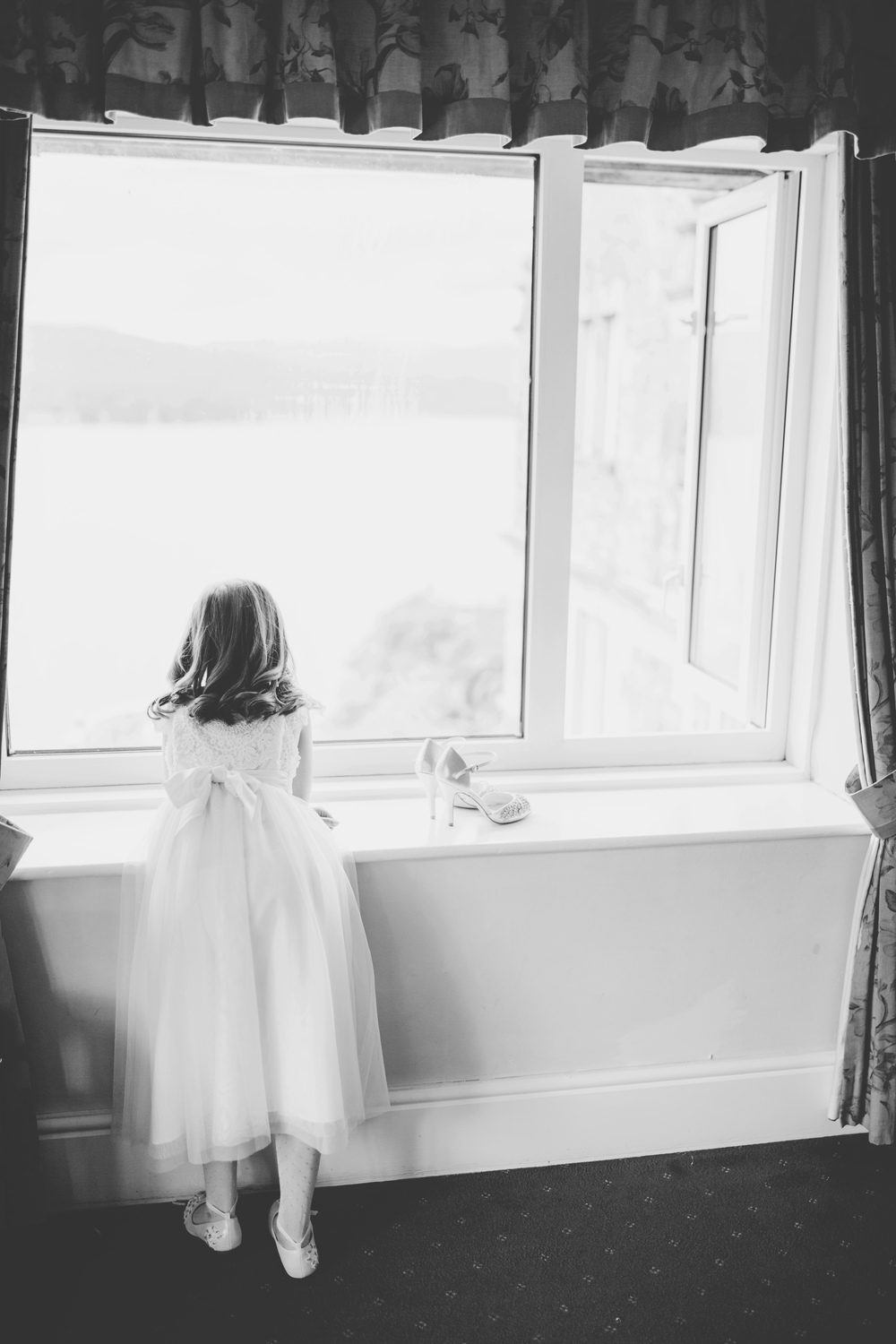 One of the bridesmaids looking out of the window- Lake district wedding