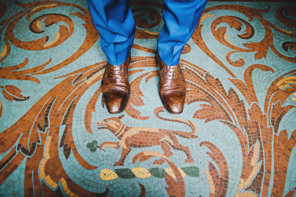 Creative photograph of the grooms shoes almost the pattern floor at Langdale Chase wedding venue