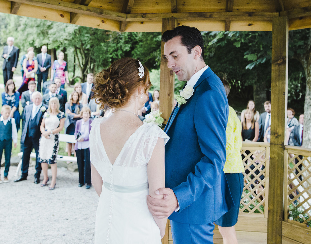 The bride and groom outside in the sun- Creative wedding assistant