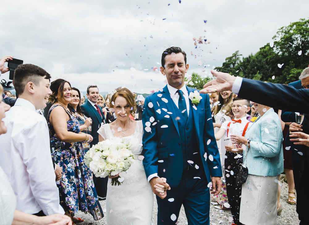 Confetti in the air at the lake district wedding