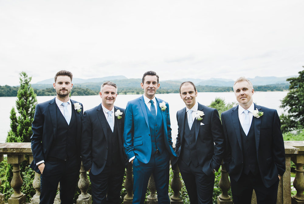 The groom and groomsmen amongst the view of the Lake district