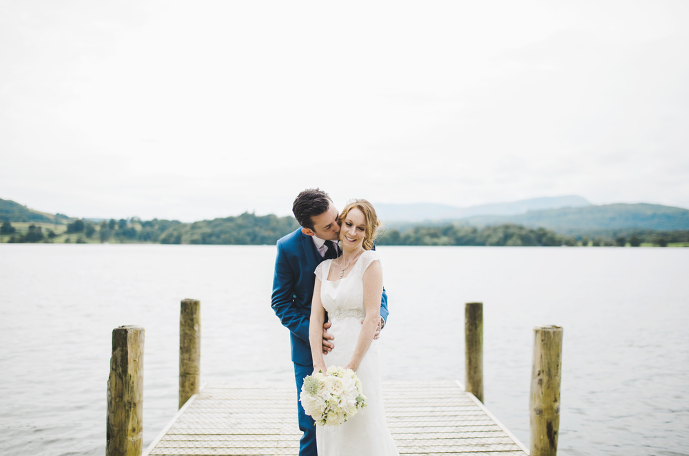 The bride and groom near the lake for a creative shot- Creative wedding photographer