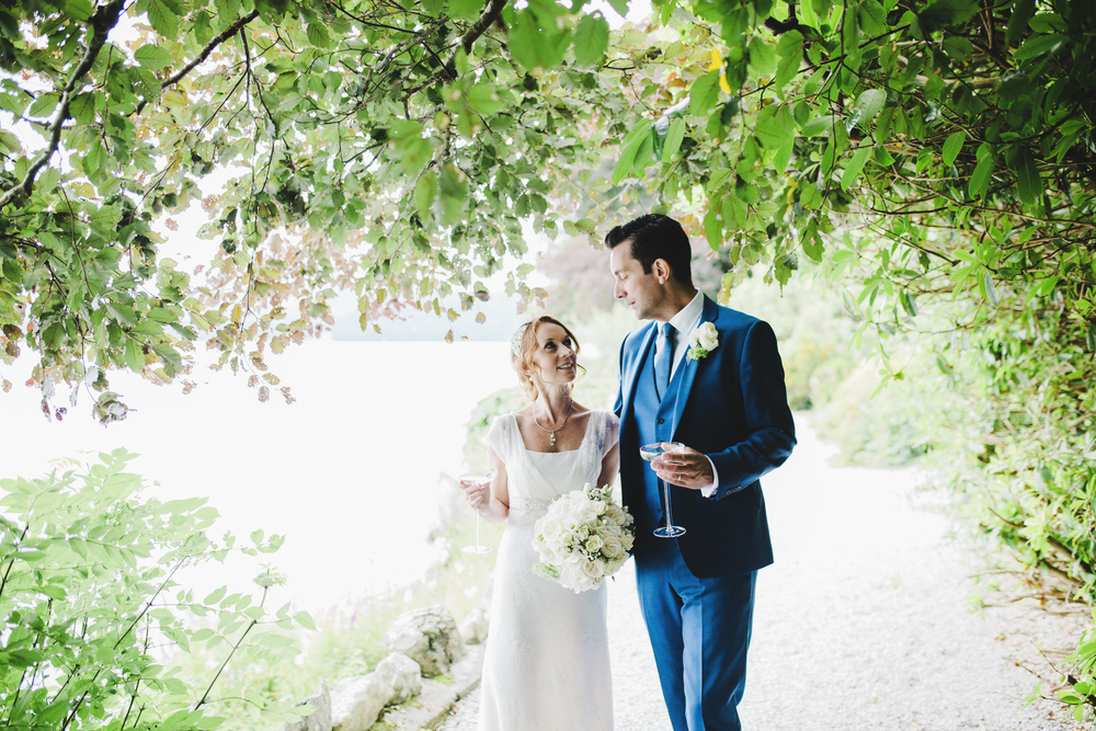 Bride and groom surrounded by trees- Documentary photographer