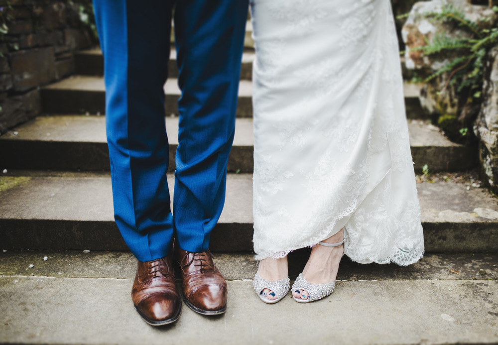 Photograph of the footwear from both bride and groom- Photographers creativity