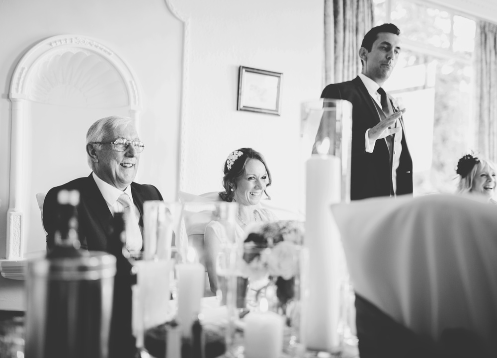 Black and white photograph of the wedding toast after the speeches- Wedding photography