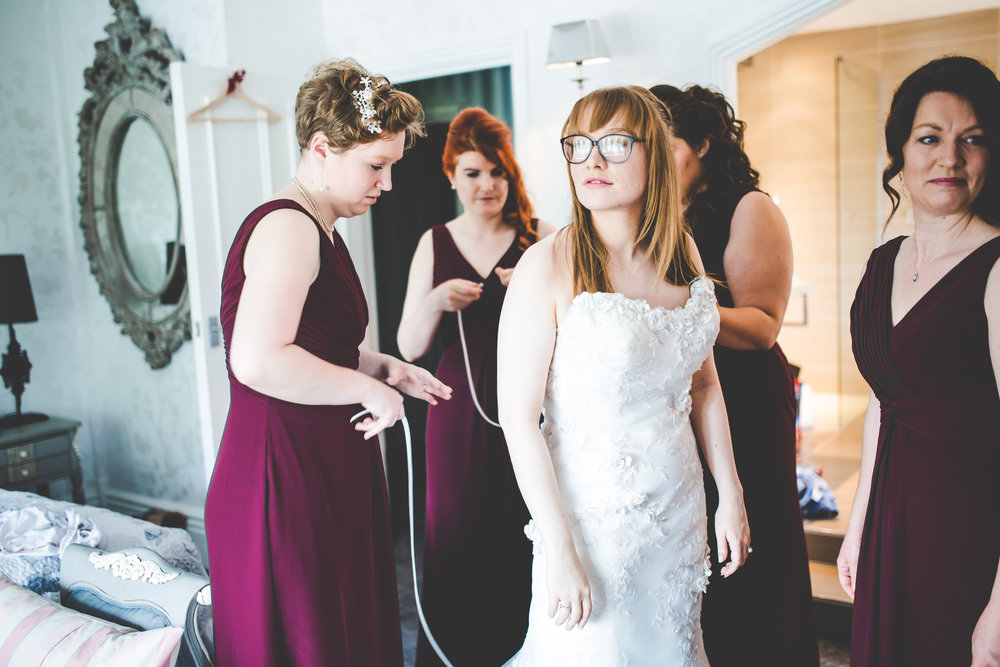 Finishes touch on the bride before the big moment- Vintage themed wedding