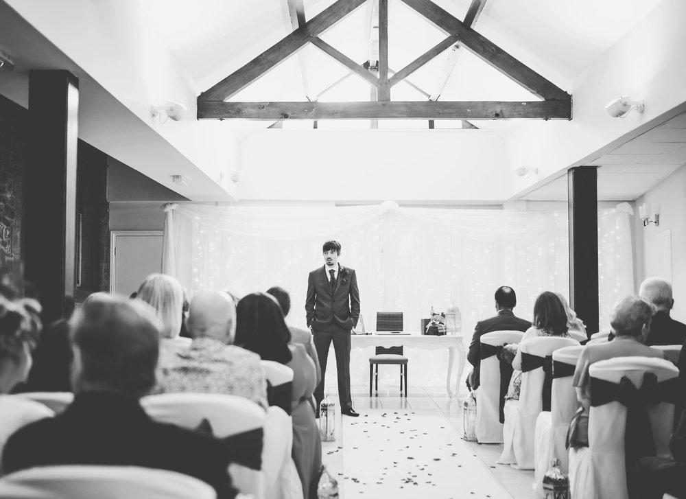 the groom waiting at the alter for his bride- Black and white wedding photography