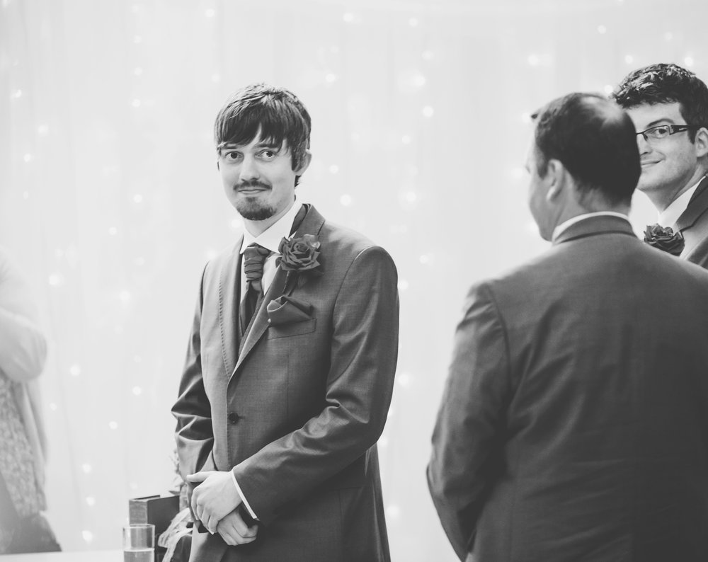 Smiles from the groom, black and white photography