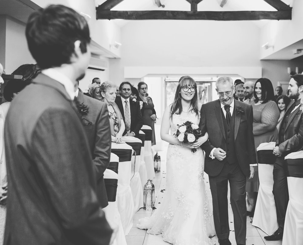 The bride walking down the aisle with her father- Lancashire wedding photography