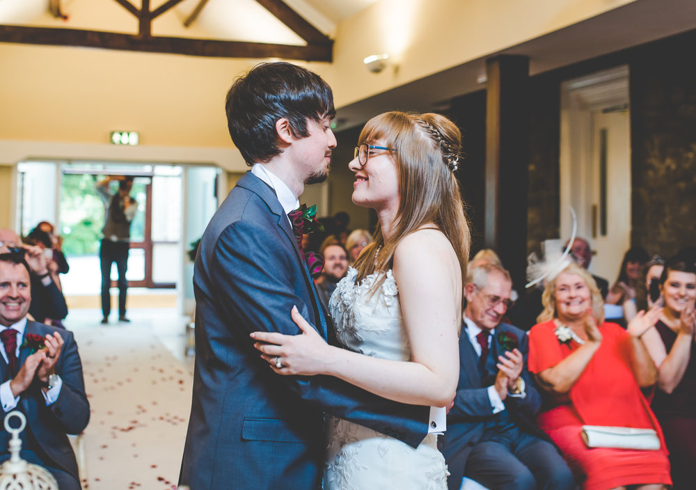 the bride and groom at the alter- Vintage themed wedding in lancashire