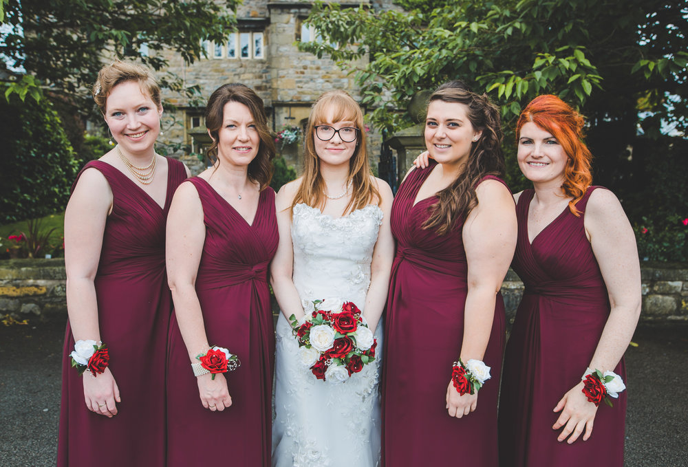 The bride and her bridesmaids outside of Stirk House